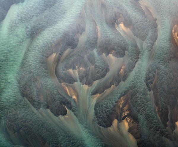 Воздушные красивые фото вулканических рек Исландии - №5
